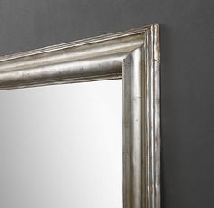 RH's Baroque Aged Silver-Leaf Mirror:Balancing Italian Baroque inspiration with clean, contemporary lines, our mirror is framed in a wide, carved wood moulding and painted to evoke the vintage luster of aged silver leaf.