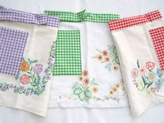 Aprons made from vintage embroidered tablecloths and gingham!
