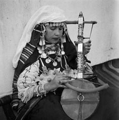 Africa | Chleuh musician playing a one-stringed rebab.  Tiznit, Morocco.  ca. 1934 - 1939. | ©Jean Besancenot.