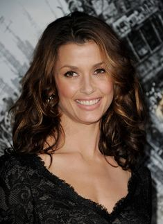 Bridget Moynahan Medium Curls  i like the color and honey brown highlights