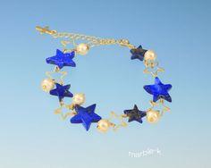 綺麗な瑠璃色の天然石ラピスラズリ。珍しい星の形です。青い色に金色の粒子が混ざって綺麗なストーンです。コットンパールをあしらいオシャレ度アップ。アジャスターにも... ハンドメイド、手作り、手仕事品の通販・販売・購入ならCreema。