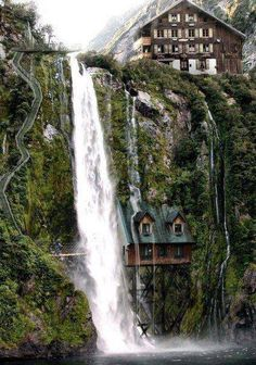 House under the waterfall, Switzerland. I feel like this would require frequent re-roofing and that would be difficult.