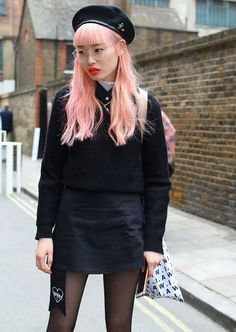 Fernanda Ly spotted on the street at London Fashion Week. Photographed by Phil Oh.