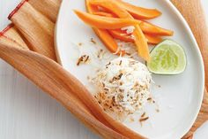 Elevate store-bought ice cream by rolling scoops in toasted coconut, and pair it with fresh tropical fruit for an easy dessert.