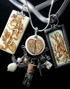 """Vintage ivory piano keys and a bone bead with wood burned images of """"wings and wishes"""""""