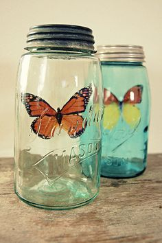 Paper butterflies in vintage mason jars makes a lovely display. #decor #jar