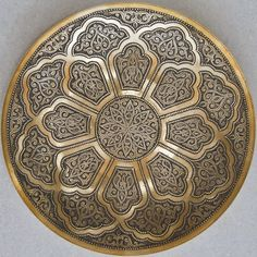 Superb brass platters, ideal for wall or table display, made by a master craftsman in Bukhara and now available for sale by Arastan