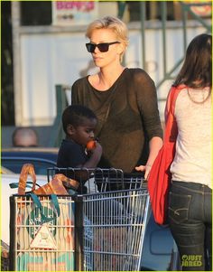 Charlize Theron in a sheer black top while stocking up on groceries at a Whole Foods market in West Hollywood, California, 22 January 2014.