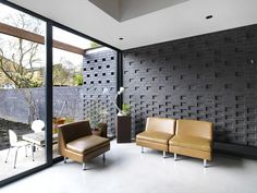 Simple palette of engineering bricks and polished concrete combine to create light wrap around extension and upgrade Brick Extension, Black Brick Wall, New Homes, 1960s House, Townhouse, House, Brick Design, Brick Wall Gardens, Exterior Wall Panels