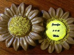 Personalized Sunflower Chocolate favors. These two creamy milk chocolate sunflowers are made with all natural ingredients, no preservatives or additives. They're gluten-free and use recycled or bio-degradable packaging when they can! Yellow and Gray Wedding | Green Bride Guide