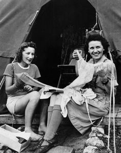 War and Conflict, World War Two, Far East, pic: circa 1943, American nurses at a New Guinea field hospital show off 'pretties' and nylons received from 'home' (Photo by Paul Popper/Popperfoto/Getty Images)