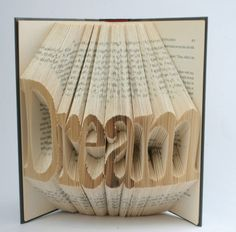 Pages of books folded to make art (3 of 10 Pics)