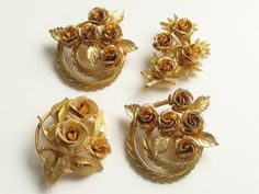 Lot 4 Rose Brooches Coro Destash by GrandVintageFinery on Etsy, $19.95. 3 are Coro Rose Brooches and the one in the second picture is not. The other 3 are signed Coro. All in gold tone and all in lovely condition. 2 are the same. Intricate 3 dimensional bouquets of roses. 1960s