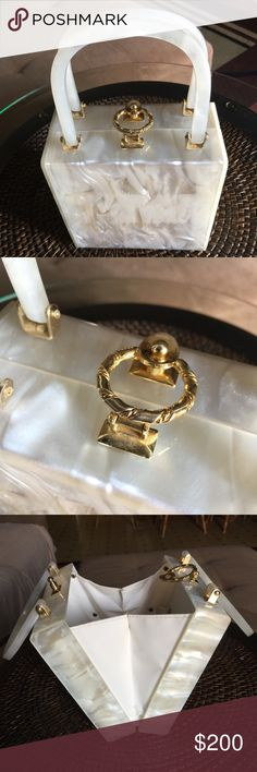 1950's Vintage purse 1950's Vintage Lucite pearlescent purse. Excellent condition! Closes with metal clasp. Bags