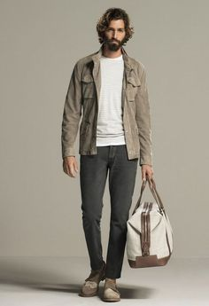 Busy days call for a simple yet stylish outfit, such as a brown field jacket and charcoal jeans. Rock a pair of brown suede double monks to show your sartorial savvy.   Shop this look on Lookastic: https://lookastic.com/men/looks/field-jacket-crew-neck-sweater-jeans/17678   — Beige Crew-neck Sweater  — Brown Field Jacket  — Charcoal Jeans  — Beige Canvas Holdall  — Brown Suede Double Monks