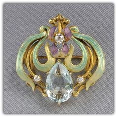 Art Nouveau 14kt Gold, Aquamarine, Enamel, and Diamond Watch Pin, the enamel iris with faceted pear-shape aquamarine and old mine-cut diamond melee.