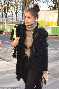 Hair she comes! Taylor Hill wore her chestnut coloured locks swept into a high bun that exposed her flawless features and stunning natural beauty
