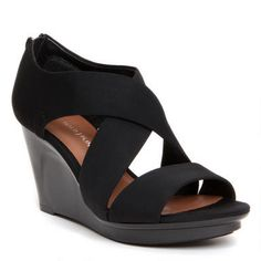The wide crisscross straps and open-toe gives the AURORA an airy feel for spring. A rear zipper provides easy wear for this fashionable wedge sandal. The cushioned footbed ensures overall comfort.Crepe elastic upperRear zipper for easy wear3 ¼ inch covered wedgeNon-slip rubber insertsImported