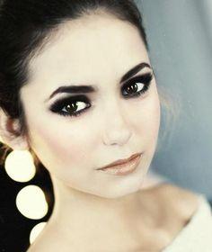 smoky eye-makeup.. Luv the dark eyes n nude lips