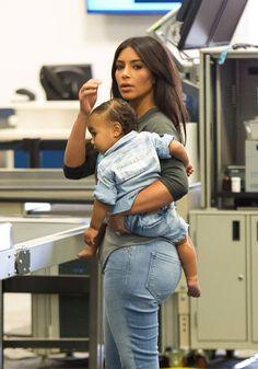 kimkardashianfashionstyle:  August 7, 2014- Kim Kardashian & North West at Burbank Airport.