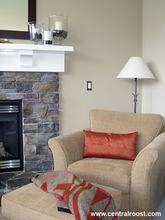 Love the wall color with the gray blue stone fireplace.  The seating could be a different color but I like the orange for fall!