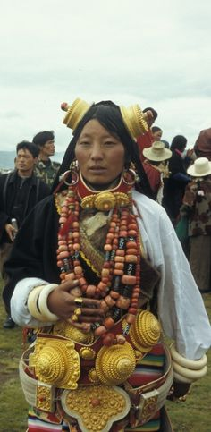 Tibetan Khampa woman from Litang at the 2007 Litang Festival. She has her hair in 108 braids, a holy number, and wears regalia owned by her family worth tens or hundreds of thousands of dollars. The gold ornaments are really gold, and the whole outfit weighs around 20kg and takes 2 hours to put on. Because Tibetans in this region are traditionally nomadic, jewellery has been the best way to store and transport their wealth, as well as hand it down through the generations