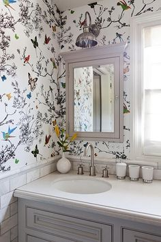 Many automatically dismiss patterned wallpaper for fear of overwhelming a room. Yet the allover pattern draws the eye up and around, adding interest that can distracts from the tiny space. - HouseBeautiful.com