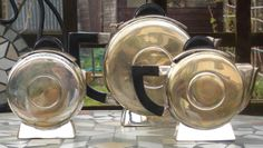 Art Deco tea set plated with Bakelite handles in a circular shape. Circa 1930's. £90  @ maxartdeco.binary-synergy.com/