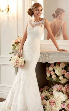 Make every exit as memorable as your entrance in this stunning Stella York Dolce Satin wedding dress with a sexy low illusion lace back, bateau illusion lace sweetheart neckline, scalloped hem, and chapel train.