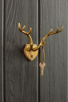 "Cast Iron Antler Wall Hook in Gold Leaf Finish. Wall-Mounted. (Hardware not included.) Dimensions: 6.75"" x 5"" x 3"""