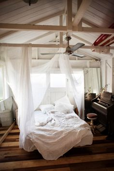 Surfboard, a piano at the side...  white messy blankets..tender blurred caos... I adore poetic feelings..