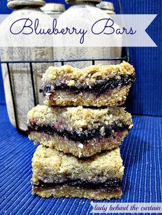 Blueberry Bars. Ingredients: flour, baking powder, salt, cinnamon, nutmeg, rolled oats, brown sugar, butter, blueberry preserves.