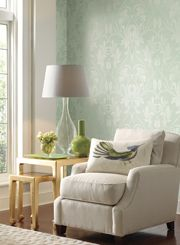 A perfect reading nook - mint wallpaper in the background, loving the bird pillow