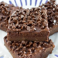 These Fudge Brownies made with Greek Yogurt and have no butter, yet they are rich, indulgent, and so chocolatey! Try this healthier brownie to satisfy that choc