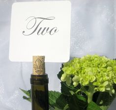 Table Numbers for the wedding - inserted into wine cork. Make custom labels for wine bottle?