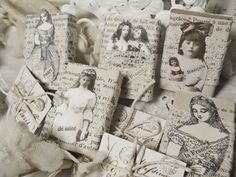 Petite altered matchboxes in vintage French style, handcrafted with vintage images, text, and lace.  Be sure to scroll down page for a peek at the set of vintage French postcards and letters tucked in each box!