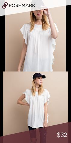 White Ruffle Top Beautiful and soft side ruffle detailed cap sleeve top.  This feminine top is a great essential for any closet! Pair this with a comfortable cardigan for the winter & pre-spring season. Wear alone in the spring with jeans or capris.   100% rayon Easel Tops