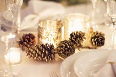 clean and simple holiday tablescape (white with mercury glass and gold acorns and gold napkin holders)  Classy and fabulous