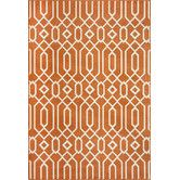 Found it at Wayfair - Baja Orange Rug. Thinking about it for my bedroom, which has warm gray and chocolate brown, and oak floors.