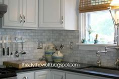 We removed the old blue laminate counters and installed Virginia Jet Mist granite and small marble subway tile backsplash.
