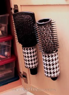 Hanging Hairbrush Storage ~ Tin Cans, Scrapbook paper, Mod Podge and Command Strips to attach them to the inside of the cabinet door... great idea!