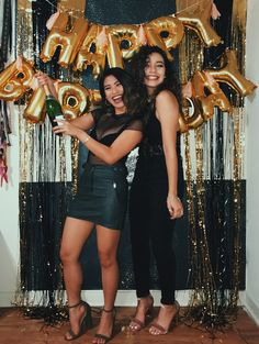 21st Birthday Celebration. We used letter birthday balloons, champagne, and all black outfits.