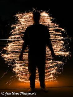 L4M2AS3 -Part A: Night Lights - M Mode - Canon EOS 80D - Shutter Speed 41.7 sec - ISO 100 - Aperture f/10 - Exposure Bias 0 step - Focal length 16mm - Handheld - Light painting backlighting someone with a sparkler to create a silhouette.