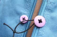 Duffel bag broken zip DIY fix with buttons and elastic.