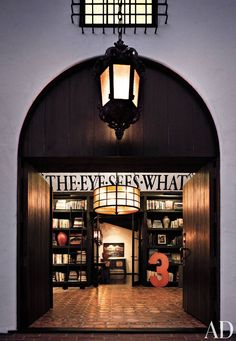 Behind monumental doors in Diane Keaton's 1920s Beverly Hills home, a double-height entrance hall is used as a library.