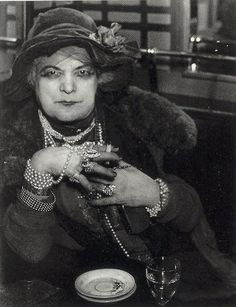 Brassai - The Prostitute Bijou in Bar de la Lune, Montmartre, Paris, 1933. ☚