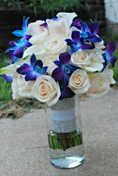 Blue Orchid wedding bouquet. Blue and purple orchids. Ivory roses