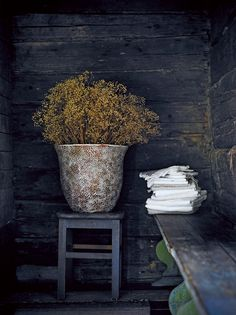 Rustic yet contemporary floral styling, oversized pots can become a feature in the corner of your space