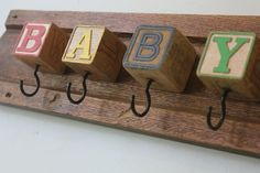 Baby Block Hook Board by bluebirdheaven on Etsy, $48.00- but could easily create this myself
