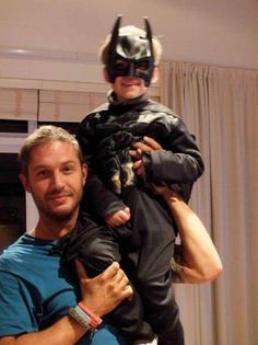Tom Hardy (bane) and his son as batman. Can this man even become hotter? The answer is no.